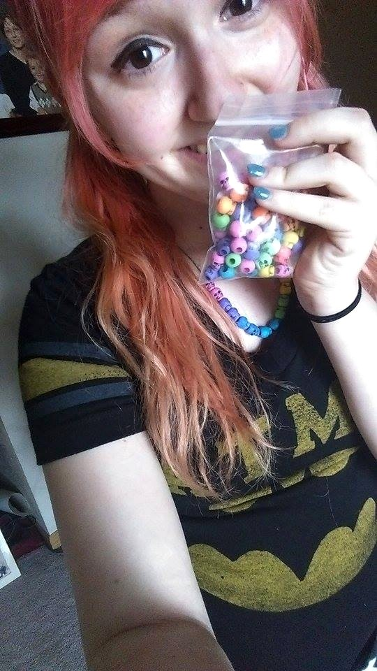 cute redhead with skull beads