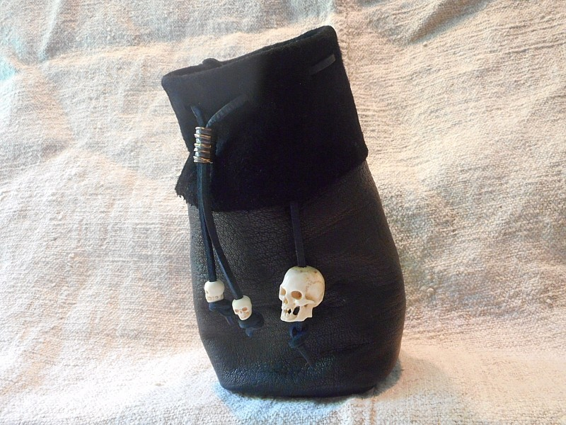 skin dice bag with bone skull beads