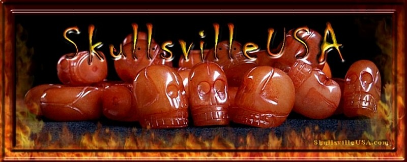carved red serpentine skull beads