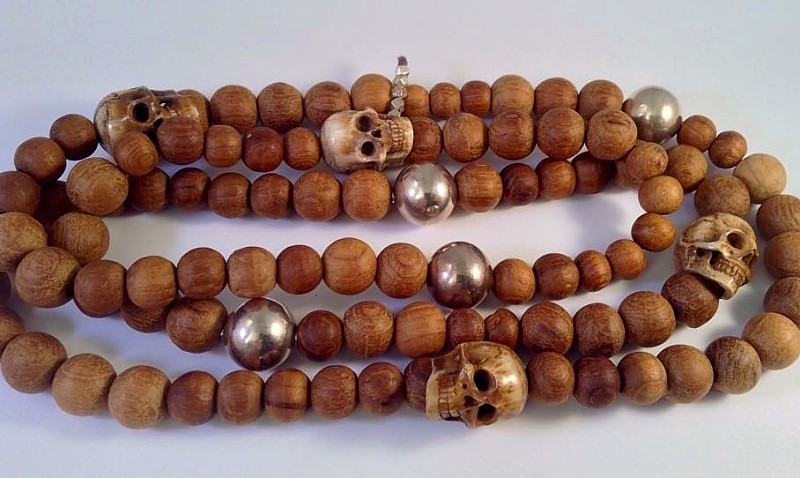 bone skull beads, teakwood and sterling silver necklace