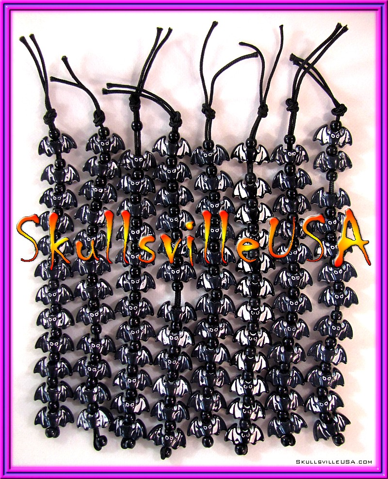 white washed black bat bead strands