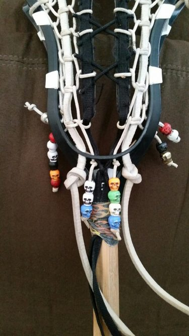 lacrosse stick or crosse with skull beads